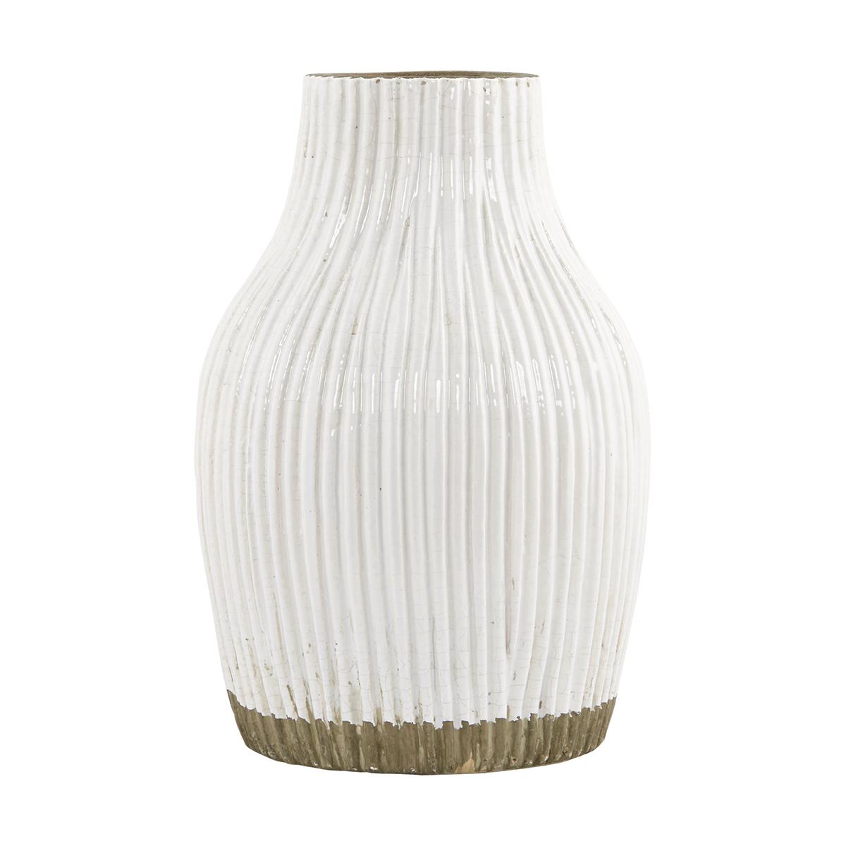 Deze robuuste vaas van house doctor is voorzien van verticale streepjes en een dip dye effect door de ...